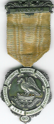 TH323 the 1901 The East Lancashire Systematic Masonic Educational & Benevolent Institution Stewards jewel with white enamel.-0
